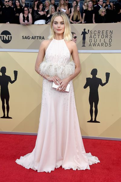<p>There's no question Margot Robbie is a bonafide fashion force.</p> <p>The style-savvy actress has brought her A-game to the awards season of 2018 and with theOscar Awards only weeks away, we can't wait to see what thenominated Robbiewill choose for film's night of nights.</p> <p>The <em>I, Tonya</em> star'sstylehas transformed from girl-next-door<em>Neighbours</em>babe into a fully-fledged fashionista.</p> <p>Her sartorial rise has been fast and ever-changing. Weather it's an edgy snakeskin Versace gown, a classic tuxedo from Givency, or a boho look in a Zimmermann dress, you never quite know what to expect from Robbie, but it's safe to assume whatever she chooses will put her at the top of Hollywood's style ranks.</p> <p>Click through to take a look at Queensland-born Robbie's style evolution with these covetable looks.<br> <br> </p>