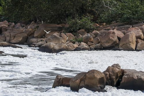 The foam is caused mostly by untreated household runoff from nearby Sao Paulo, the biggest city in Brazil. (AP Photo/Marcelo Chello)