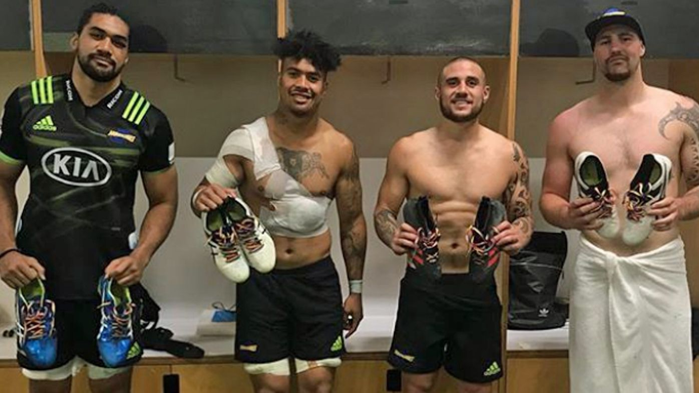 Hurricanes players hold up heir rainbow laces