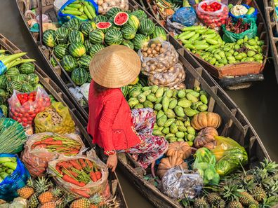 Woman selling on floating market in Vietnam