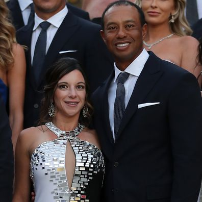 Tiger Woods of the United States poses with girlfriend Erica Herman before the Ryder Cup gala dinner.