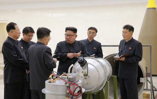 Kim Jong-un inspects the newly built mini hydrogen bombs. (Reuters/KCNA)