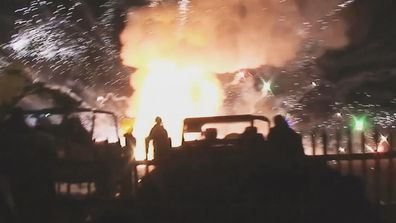 There was a large fire as fireworks exploded into the surrounding area.