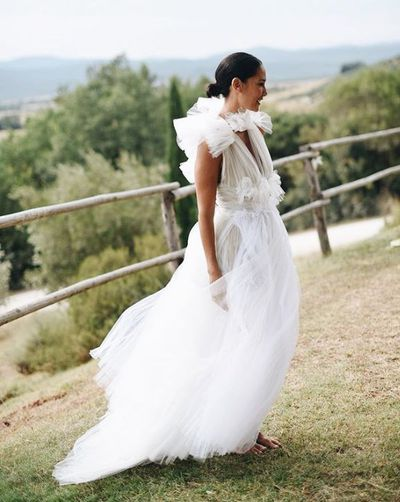 "<p>Model and Balinese Princess Lindy Klim has wed beau Adam Ellis overnight in a dream Tuscany <a href=""https://style.nine.com.au/2018/04/30/11/28/deborah-symond-wedding"" target=""_blank"" title=""wedding"" draggable=""false"">wedding</a>.</p> <p>The bride looked breathtaking in a tulle gown by her favourite go-to Australian designer Toni Maticevski. The 40 year-old kept her hair simple and chic in a low bun with centre part and roamed barefoot, letting her dramatic gown do the talking.</p> <p>The happy couple <a href=""https://style.nine.com.au/2018/07/23/15/14/wedding-style-anna-heinrich"" target=""_blank"" title=""exchanged nuptials"" draggable=""false"">exchanged nuptials</a> in front of close friends and family who flew in for the pair's special day.</p> <p>Lindy's three children with ex husband Michael Klim; Stella, 11, Rocco, nine and Frankie, six, were there to witness their mum say 'I do', as was the newlyweds eight-month old daughter, Goldie.</p> <p> Maticevski posted an image of the new bride on his Instagram page, gushing over her wedding day look. ""Nothing but love for you @lindyklim and Adam. #barefoot #beauty#maticevski #bride.""</p> <p>The British property developer and the mother of four chose the picture-perfect luxury resort, Conti di San Bonifacio to exchange vows.</p> <p>Klim and Ellis met two years ago, got engaged eight months later and in December last year welcomed their first daughter together.  <br /> <br /> </p>"
