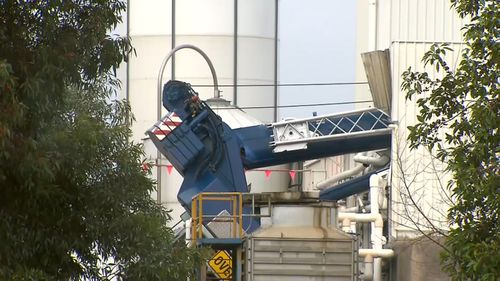 A crane has collapsed onto a factory in Dandenong South.