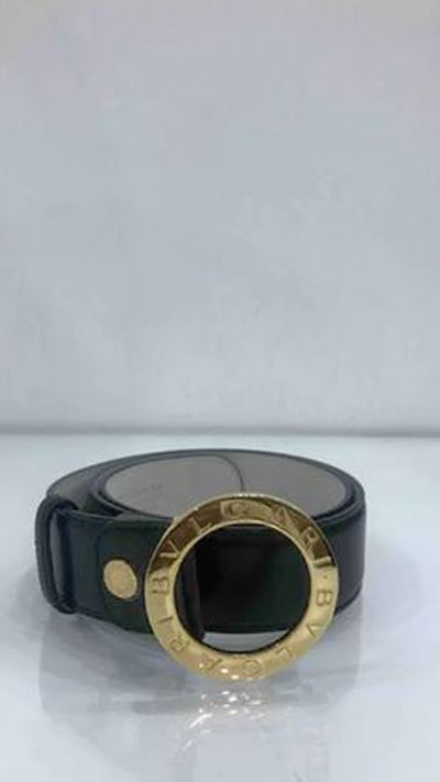 "Vintage Bulgari belt, approx. $335 at <a href=""http://www.vestiairecollective.com/women-accessories/belts/bulgari/black-leather-bulgari-belt-4223898.shtml"" target=""_blank"" draggable=""false""><strong>Vestiaire</strong><br /> </a>"