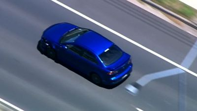 The blue car was seen speeding and driving on footpaths and the median strip through suburban streets and past at least one school. (9NEWS)