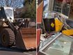 Front-end loader used as battering ram in bizarre break-in
