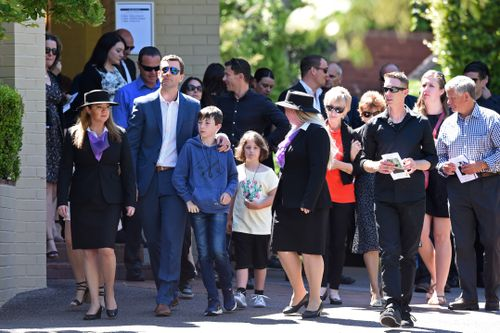The husband and son of Cindy Low, Matthew and Kieran (left), depart with other mourners following her funeral at the Palmdale Hillside Chapel on the Central Coast. Picture: AAP