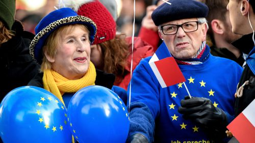 European Union supporters wait outside during the signing of a new Franco-German friendship treaty in Aachen, Germany.