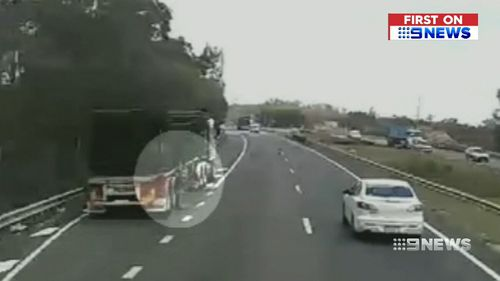 Mr Holland was securing a load on his truck when he was hit. (9NEWS)