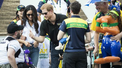Prince Harry spoke with the team members and their families.