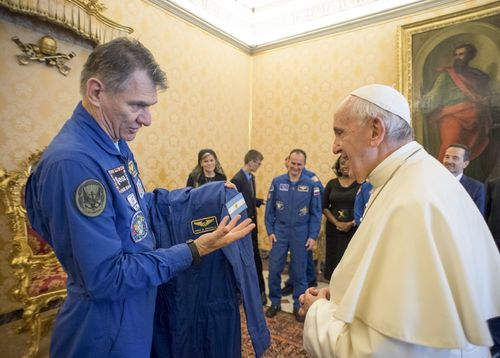 The Pope looked pleased as he was given the special suit. (AAP)