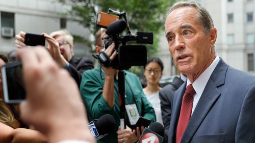US Republican Congressman Chris Collins speaks to reporters as he leaves the courthouse after a pretrial hearing in his insider-trading case, in New York.