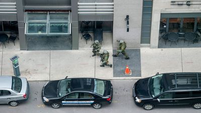 Heavily armed police on Queen Street in Ottawa. (AAP)
