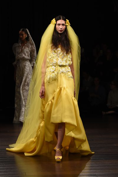 <p>Yellow cheer</p> <p>A warm and welcoming yellow relates to the mind and intellect. A smart choice for smart types.</p> <p>Naheem Khan, spring 2017, New York Bridal Fashion Week</p>