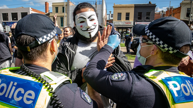 Protesters clash with Police at the Queen Victoria Market on September 13, 2020 in Melbourne, Australia. (Photo by Darrian Traynor)