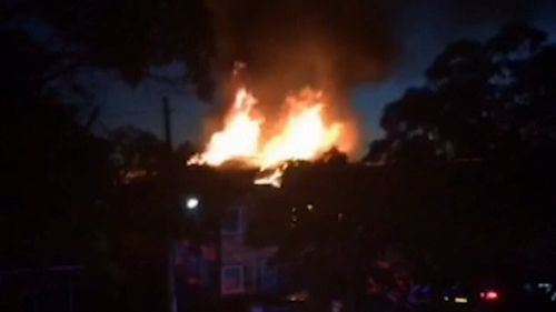 Thick black smoke and flames at least three metres high could be seen (9NEWS)