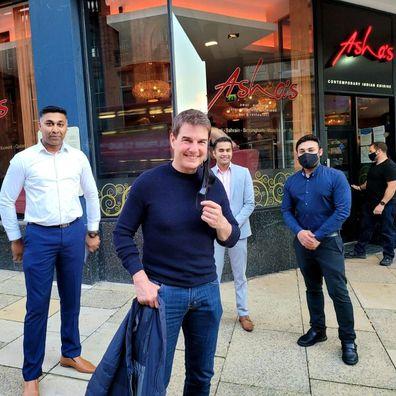 Tom Cruise with staff at Asha's restaurant in Birmingham, UK