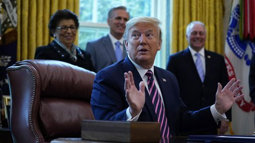 President Donald Trump speaks after signing a coronavirus aid package to direct funds to small businesses, hospitals, and testing, in the Oval Office of the White House, Friday, April 24, 2020, in Washington