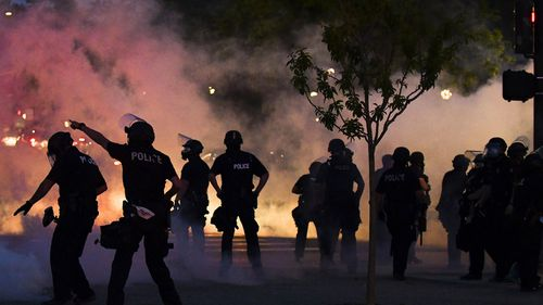 Police officers fire tear gas at protesters near the Colorado state capitol during a protest on May 29, 2020 in Denver, Colorado. This was the second day of protests in Denver, with more demonstrations planned for the weekend.