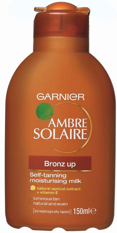 """<a href=""""http://www.garnier.com.au/tan/beauty/ambre-solaire?gclid=CPmijf_h9dICFYkHKgodu3wPdw"""" target=""""_blank"""">Garnier Ambre Solaire Bronz Up Moisturising Milk, $10.95.</a><br> Designed to moisturise the skin while it develops a natural-looking tan. And it actually does!"""