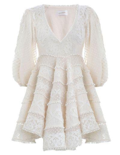 """<p>Margot's exact dress: <a href=""""https://www.zimmermannwear.com/painted-heart-sun-dress-cream.html"""" target=""""_blank"""" draggable=""""false"""">Zimmermann painted heart sun dress</a>, $2,950.00</p>"""