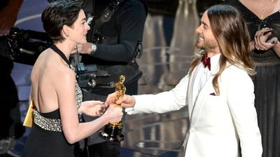 Jared Leto accepts the Best Supporting Actor Oscar from Anne Hathaway for his role in the Dallas Buyers Club.