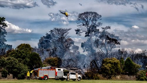 A water bomber helicopter is used to extinguish the fire. (Image: AAP)
