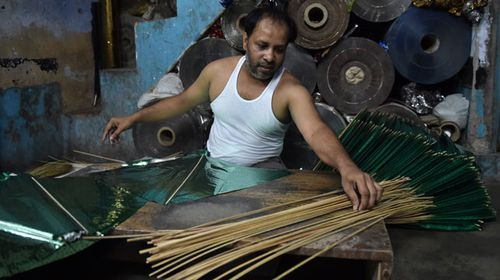 A kite maker in India. (AFP)