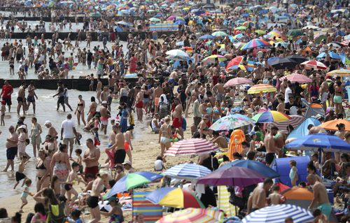 People in England enjoy the hot weather on Durley and Alum Chine beaches. England, last weekend.