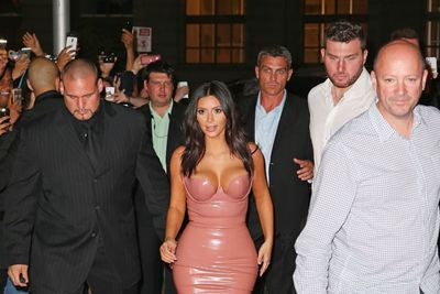 Kim, 33, arrived surrounded with her security team.