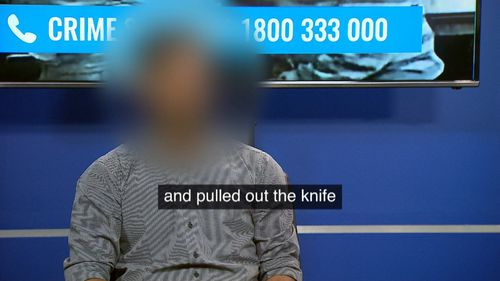 The attendant had a knife held at his abdomen.