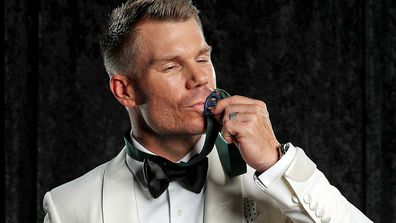 David Warner poses with the Allan Border Medal