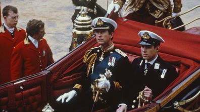 Charles, Prince of Wales and his brother Prince Andrew make their way by coach to St Paul's Cathedral, for Charles' wedding to Lady Diana Spencer, London, 29th July 1981
