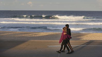 Residents of Sydney make the most of the last light of the day at Maroubra
