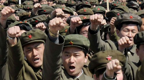North Koreans hold a mass rally in Pyongyang's Kim Il Sung Square. (AAP)