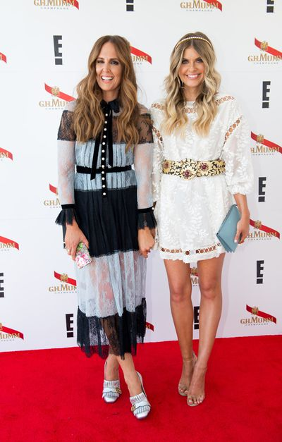 Tash Sefton in Philosophy dress and Gucci shoes with Elle Ferguson in Zimmermann with a Miu Miu headpiece.