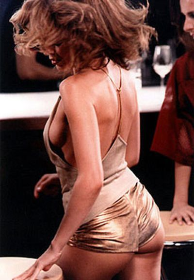 Kylie in her now-iconic gold hotpants in the music video for 'Spinning Around'.
