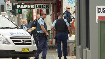 Police outside a property in Fairy Meadow, four kilometres outside of Wollongong's city centre.