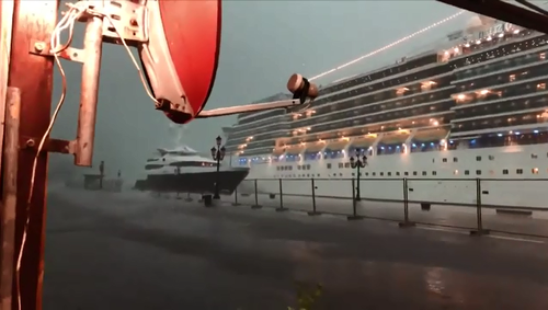 A cruise ship in Venice almost hit a smaller yacht during a freak hail storm on Sunday.