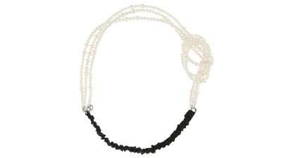 """<a href=""""http://www.net-a-porter.com/product/512724/Maison_Michel/alina-knotted-faux-pearl-headband"""" target=""""_blank"""">Alina Knotted Faux Pearl Headband, $261.34, Maison Michel</a>"""