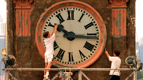 Daylight saving finishes this weekend with the clocks being put back one hour.Pic Shows; Painter, Wayne Fleming of Minchenbury working on the Balmian Post Office Tower clock, playfully trys to stop time while co-worker, David Hamilton works on.