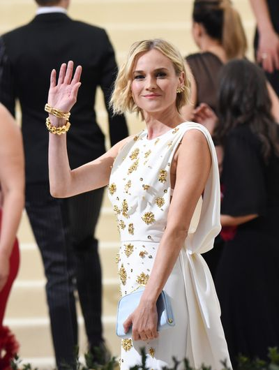 <p>Diane Kruger, 40</p> <p>Tucking your hair behind your ears is an easy way to tap into the androgynous trend without lopping your locks.</p>