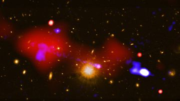 Astronomers made the discovery using NASA's Chandra X-ray Observatory, along with other telescopes. They found the black hole at the centre of a galaxy located 9.9 billion light-years from Earth, and the galaxy itself has seven galactic neighbours.