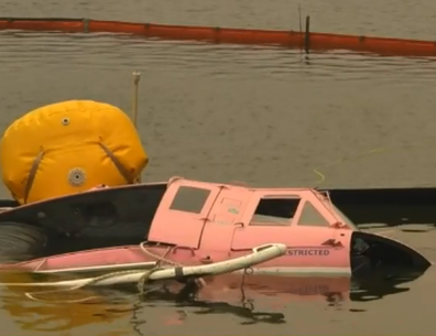 "The remains of his pink waterbomber ""Lucy""."