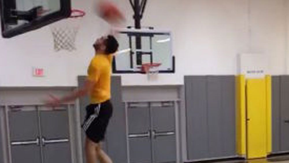 Missed dunk turns into trick shot