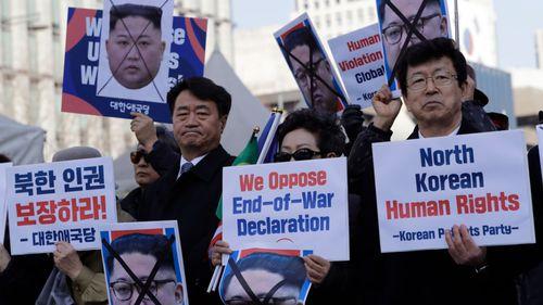 South Korean protesters and North Korean defectors in Seoul.