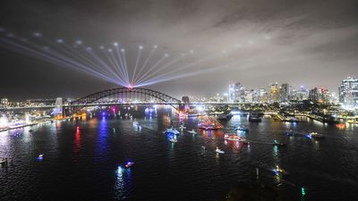 Ships pass under the Sydney Harbour Bridge on Sydney Harbour at the end of the Year's Eve celebrations in Sydney, Tuesday, December 31, 2019.