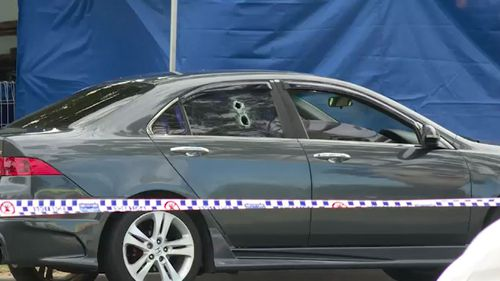 A car was found with two bullet holes in it.